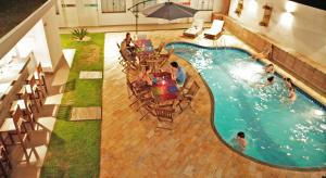 A view of the pool at Concept Design Hostel & Suites or nearby