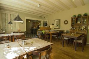 Een restaurant of ander eetgelegenheid bij Hotel-Pension Zoom-Oord