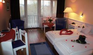 Ein Zimmer in der Unterkunft Landhotel Combecher