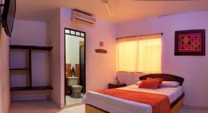 Кровать или кровати в номере Hotel Katio