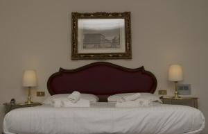 Cama ou camas em um quarto em Hotel Goldoni