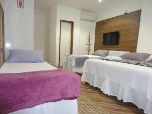 A bed or beds in a room at Pousada Pedacinho da Bahia