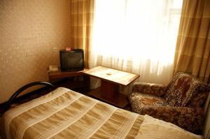 Телевизор и/или развлекательный центр в Гостиница Гранит