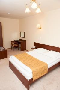 Кровать или кровати в номере Гостиница Гранит