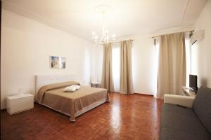 A bed or beds in a room at B&B Tarì