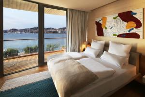 A bed or beds in a room at D-Resort Šibenik