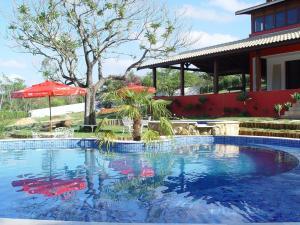 A piscina localizada em Pousada Rural Paraíso ou nos arredores