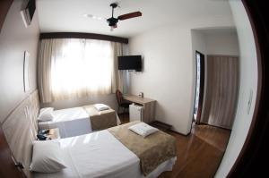 A bed or beds in a room at Rhud's Hotel