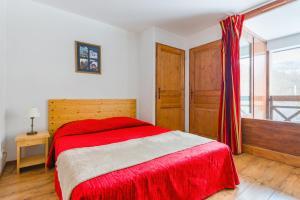 Кровать или кровати в номере Lagrange Vacances Cybèle