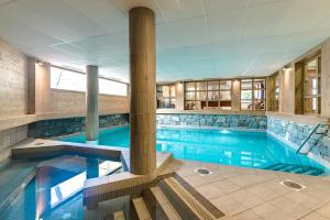 The swimming pool at or near Lagrange Vacances Les Fermes Emiguy