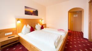 Postel nebo postele na pokoji v ubytování Pension Steiermark