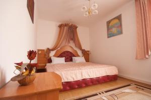 Ліжко або ліжка в номері Готель Волтер