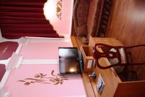 Телевізор і / або розважальний центр в Готель Волтер