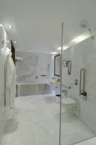 A bathroom at The Library Hotel Wellness Retreat