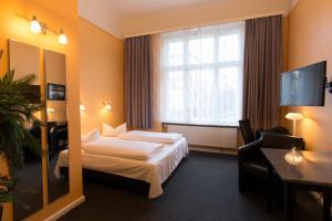 Ein Bett oder Betten in einem Zimmer der Unterkunft Hotel am Hermannplatz