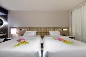 Кровать или кровати в номере Veranda Resort Pattaya - MGallery by Sofitel