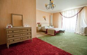 Łóżko lub łóżka w pokoju w obiekcie Hotel Pałacyk Konin