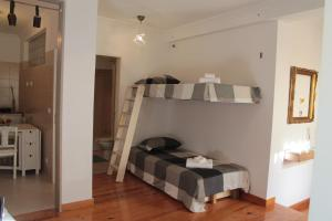 A bunk bed or bunk beds in a room at Casa d Sintra
