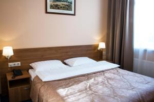A bed or beds in a room at Maleton Hotel (Anokhina)