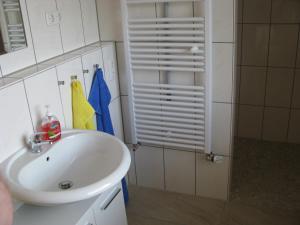 Ein Badezimmer in der Unterkunft Ferienunterkünfte Boßmann
