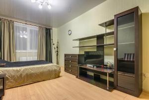 Телевизор и/или развлекательный центр в ATLANT Apartments 106