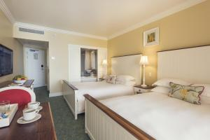 A bed or beds in a room at Wild Coast Sun
