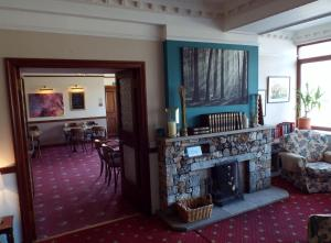 The lounge or bar area at The Dundonnell Hotel