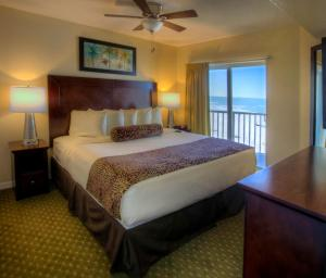 A bed or beds in a room at Sunset Vistas Two Bedroom Beachfront Suites