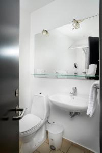 Et badeværelse på Trinity Hotel & Konference Center