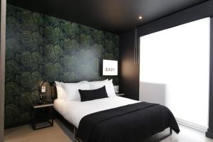 A bed or beds in a room at Kip Hotel