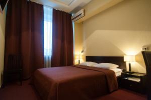 Кровать или кровати в номере Отель Планета Спа