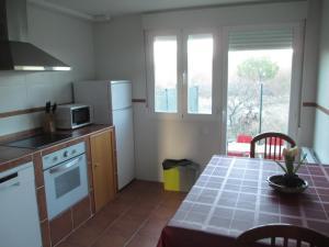 Una cocina o zona de cocina en Casa El Mirador Encinar