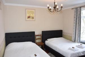 Un ou plusieurs lits dans un hébergement de l'établissement Dolce Villa Pool and Wellness