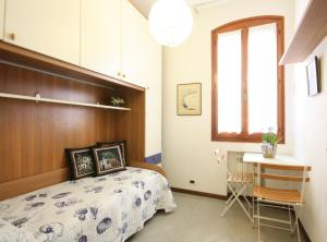A bed or beds in a room at Tiepolo