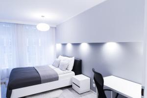 Łóżko lub łóżka w pokoju w obiekcie Apartament na Starówce Ogarna