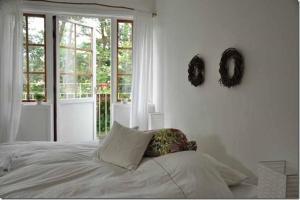 Säng eller sängar i ett rum på B&B Åvägen