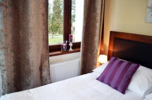 Кровать или кровати в номере Hotel U Kvapilů