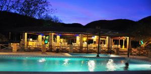 The swimming pool at or near Fazenda Hotel Pedra dos Ventos