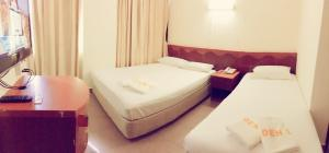 A bed or beds in a room at Golden Star Hotel (SG Clean)
