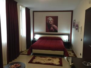 Letto o letti in una camera di Merylinn Guest House