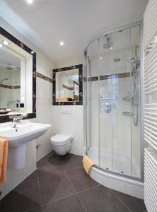 Ein Badezimmer in der Unterkunft Hotel Landhaus Berghof