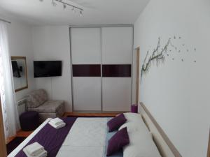 A bed or beds in a room at Apartment 4M
