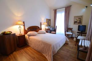 Ένα ή περισσότερα κρεβάτια σε δωμάτιο στο Korina Gallery Hotel