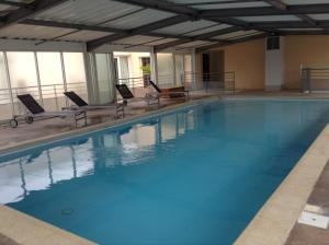 The swimming pool at or near The Originals City, Hotel Otelinn, Caen (Inter-Hotel)