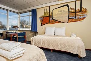 Een bed of bedden in een kamer bij Pension Homeland