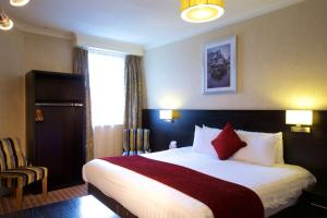 A bed or beds in a room at Chester Station Hotel, Sure Hotel Collection by Best Western