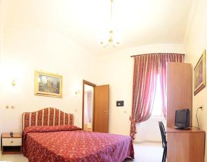 Letto o letti in una camera di Hotel Euro Quiris