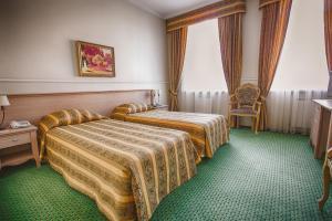 Кровать или кровати в номере Гостиница Эрмитаж Ростов-на-Дону
