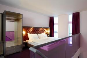 A bed or beds in a room at abito Suites