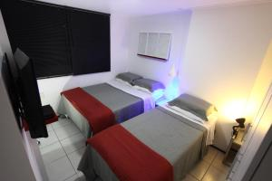 A bed or beds in a room at Atlantic Ocean Residence